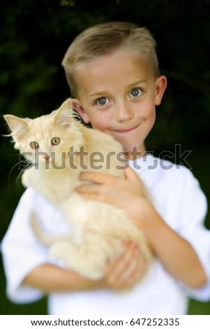 Boy posing with cat #647252335
