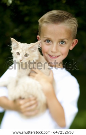 Boy posing with cat #647252638