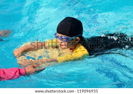 Boy Practice Swimming