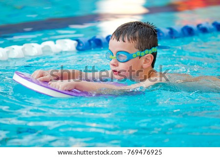 Boy Practice Swimming #769476925