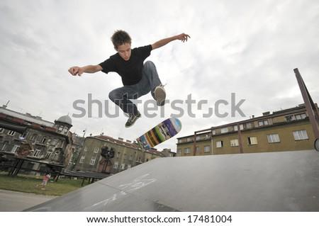 Boy practicing skate in a skate park - stock photo