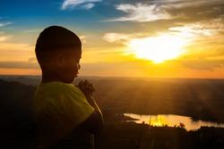 Boy praying on the Mount, thank God.