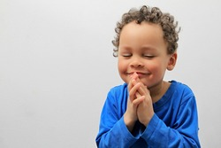 boy praying to god with a smile on his face stock image stock photo