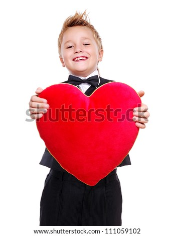 Boy presenting heart pillow