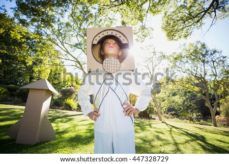 Boy pretending to be an astronaut in park Stock photo ©