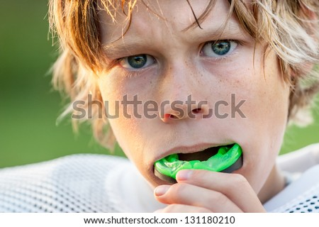 Boy putting in his mouth guard ストックフォト ©