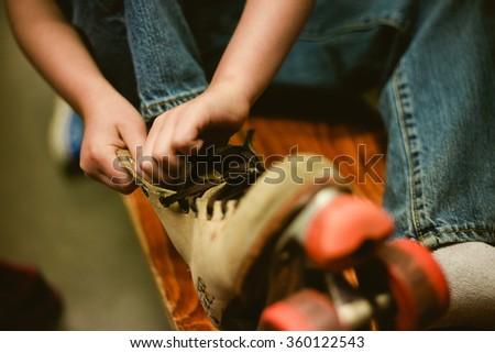 boy putting on skate #360122543