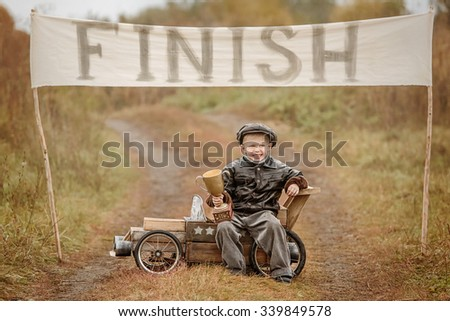 Boy Racer With His Homemade Wooden Car Images And Stock Photos