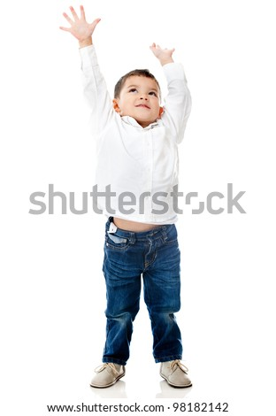 Boy reaching ceiling with arms up - isolated over a white background