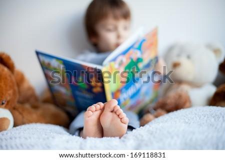 Boy, reading a book, educating