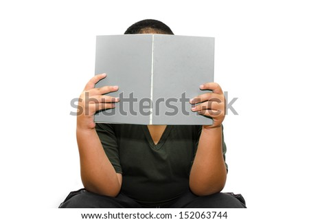 Boy reading a book , isolated over white background