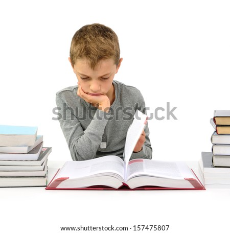 Boy reading a book, learning - stock photo