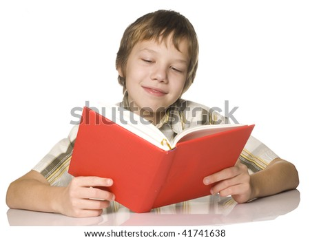 Boy reading a red book