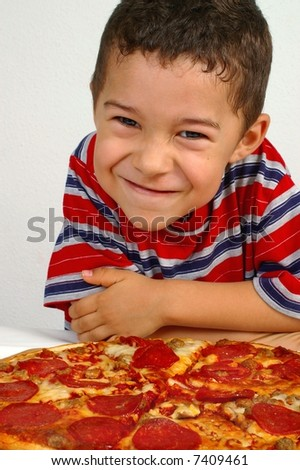 Boy ready to eat a pepperoni pizza