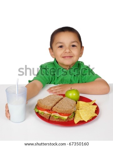 Boy ready to eat a sandwich meal, four years old