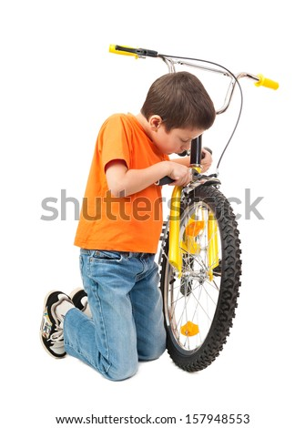 boy repair bicycle isolated on white