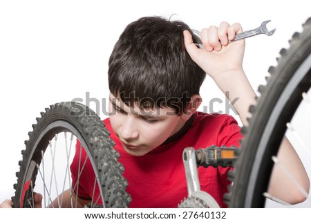 boy repairing the bicycle, isolated over white