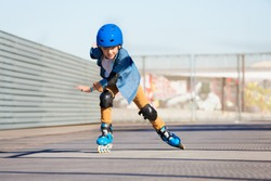 Boy riding on roller skates at outdoor  skate park