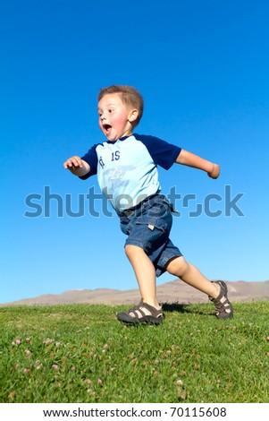 boy running across hill