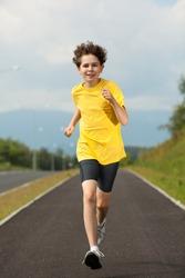 Boy running, jumping