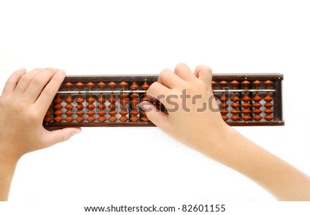 Boy's hands accounting with the abacus