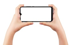 Boy's Hands Holding Phone Isolated on White Background. Child's Hands Hold Black Smartphone and Making Photos in Horizontal Position. Screen Blank. Close-Up.