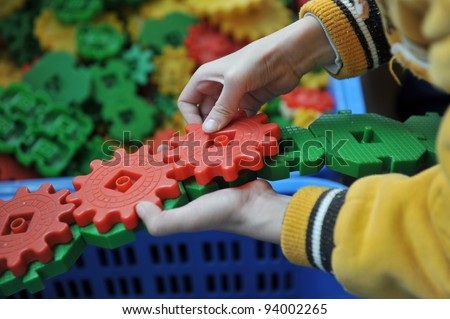 boy's hands keeping slice puzzle try its collect.