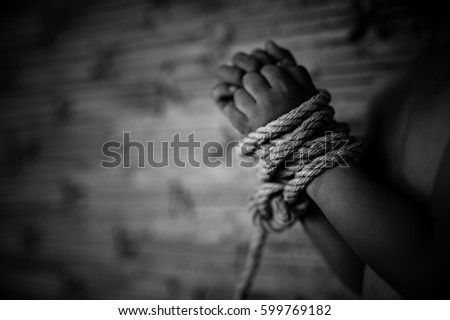 Boy's hands were tied with a rope, child bondage , violence, terrified , A fearful child , Human Rights Day concept. #599769182