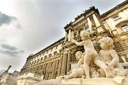 Boy's sculpture in front of The building of Naturhistorisches Museum (Museum of Natural History) in Vienna, Austria