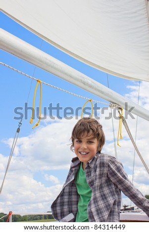 boy sailing on yacht in cloudy day