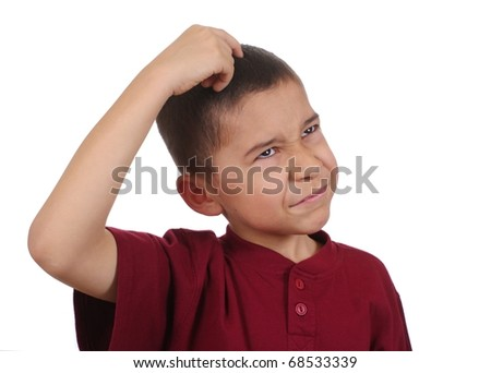 Boy scratching head confused, eight years old, isolated on pure white background