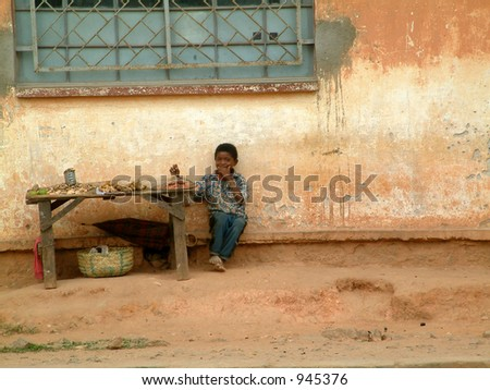 Boy selling food at stall in Madagascar,Africa. - stock photo