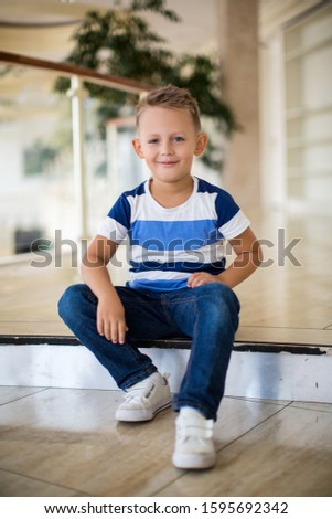 boy sits on a step
