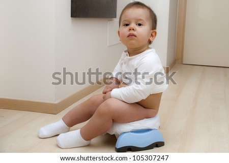 Boy sitting on a traveling potty
