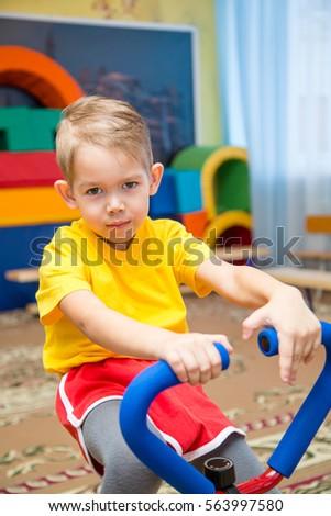 boy sitting on gym apparatus #563997580