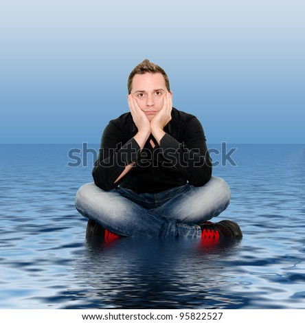 boy sitting on the water