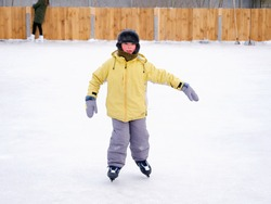 boy skating on an outdoor ice rink 2021