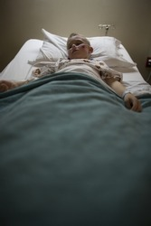 Boy sleeping in hospital bed