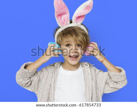 Boy Smiling Easter Holiday Concept #617854733