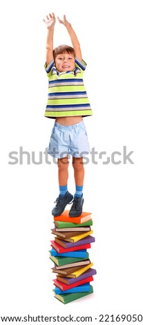 Boy stand on the books