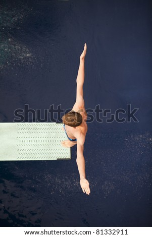 Boy standing on springboard