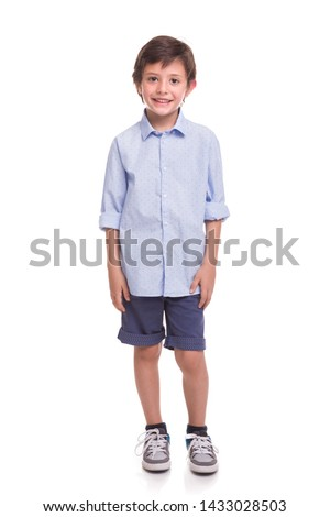 Boy standing smiling on a white background #1433028503