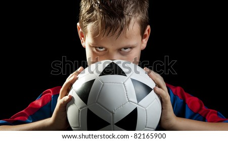 boy stares with ball frontal