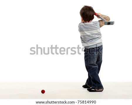Boy stay back and preparing to hit a golf ball isolated on white