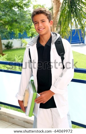boy student teenager backpack holding books at home outdoor smiling