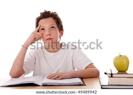 boy studying and thinking, along with one on apple top of some books - stock photo