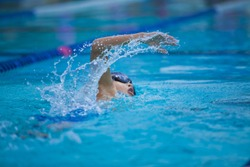 boy swim in the pool