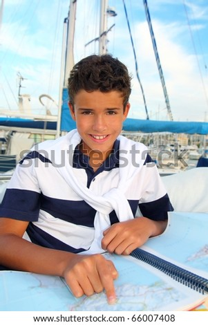 boy teen sailor sitting on marina boat chart map smiling in summer vacation
