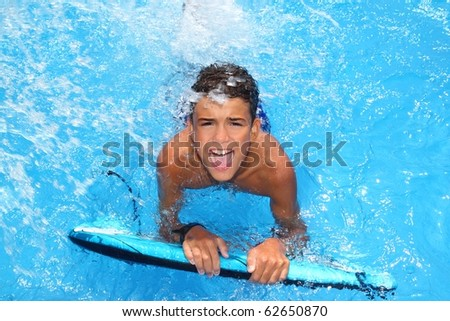 boy teenager surfboard splashing blue water happy in sea pool