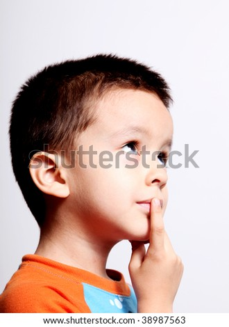 boy thinking and looking up over white background